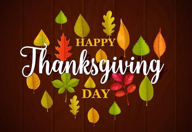 Tipografia felice giorno del ringraziamento con foglie cadute su fondo in legno. grazie dando congratulazioni con foglie di acero, quercia, betulla o sorbo. vacanze di stagione autunnale, fogliame di caduta dell'albero
