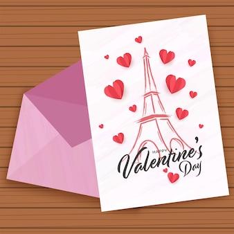 Cartolina d'auguri di san valentino felice con la busta su fondo di legno marrone.