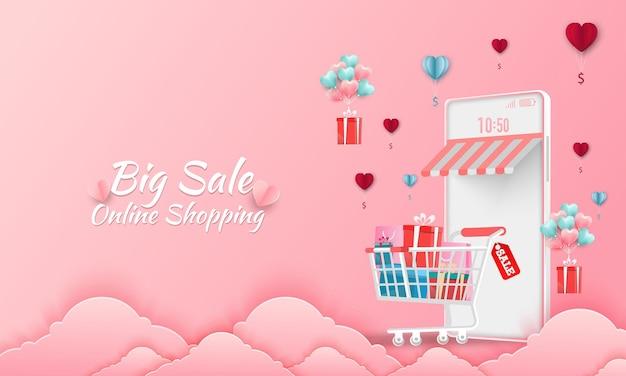 Felice banner di vendita di san valentino. negozio di acquisti online con dispositivi mobili, carte di credito ed elementi del negozio.