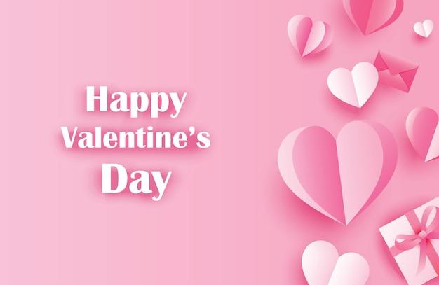Auguri di felice giorno di san valentino con cuori di carta su sfondo rosa pastello.