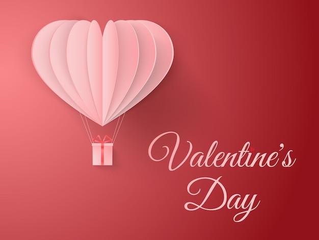 Saluti felici di san valentino con carta tagliata a forma di cuore e palloncino volante su sfondo rosso.