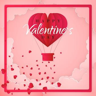 Modello di carta di invito felice giorno di san valentino con mongolfiera di carta origami a forma di cuore, nuvole bianche e coriandoli. sfondo rosa.