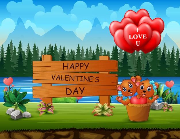 Felice giorno di san valentino segno con coppia orso e palloncini cuore