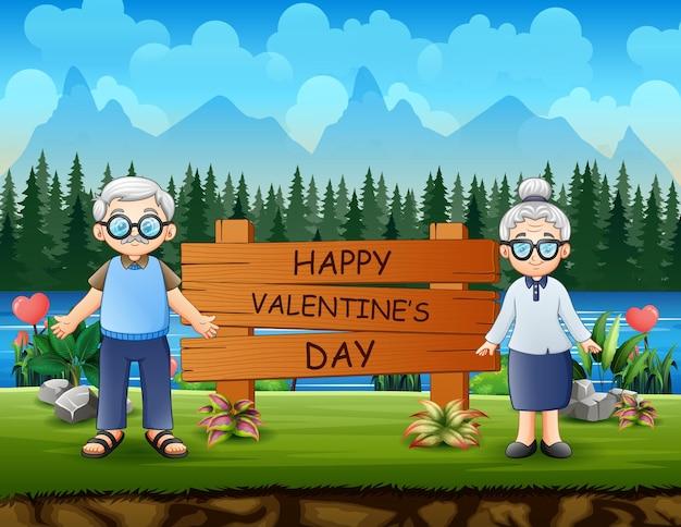 Segno felice di giorno di biglietti di s. valentino con un nonno delle coppie