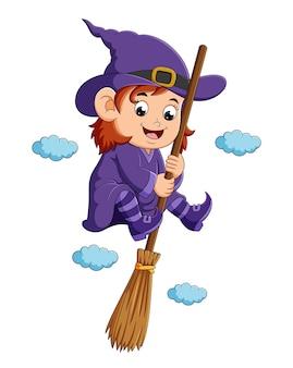 La strega felice sta volando con la scopa magica nel cielo dell'illustrazione