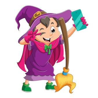 La strega felice sta facendo un selfie con la scopa magica dell'illustrazione