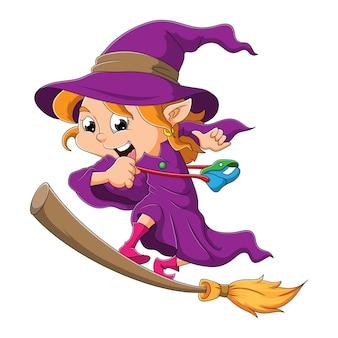 La strega felice è in piedi nella scopa magica dell'illustrazione