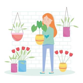 Donna felice in possesso di una pianta e piante intorno su sfondo bianco