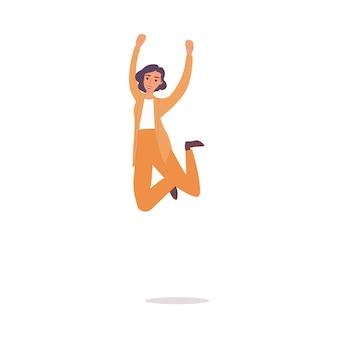 Donna felice in tailleur giallo che salta in aria e sorride