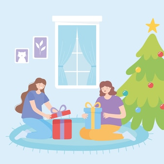 Donne felici sul tappeto celebrazione di natale apertura scatole regalo illustrazione vettoriale