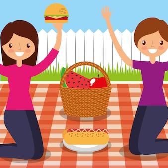 Amici felici delle donne che hanno picnic