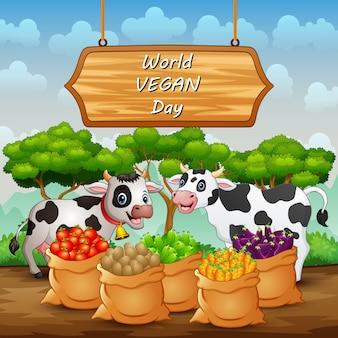 Fondo felice del segno di giornata mondiale vegana con mucca e verdure