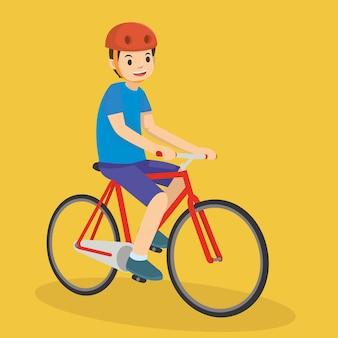 Felice ragazzo in sella a una bicicletta