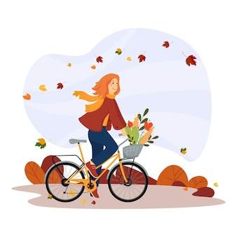 La ragazza felice va in bicicletta nel parco stile di vita sano e ricreazione attiva