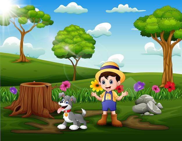 Felice giovane uomo e il suo animale domestico nel parco