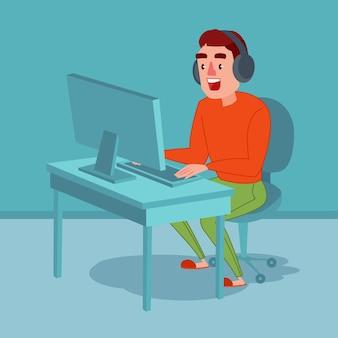 Giovane felice con le cuffie che giocano gioco per computer