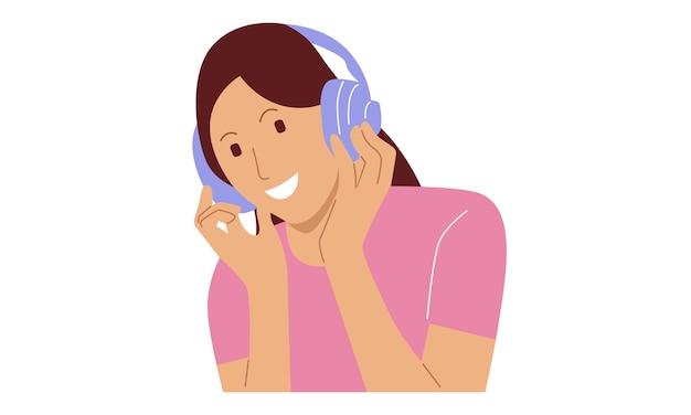 Giovane donna felice che ascolta la musica sulle cuffie senza fili