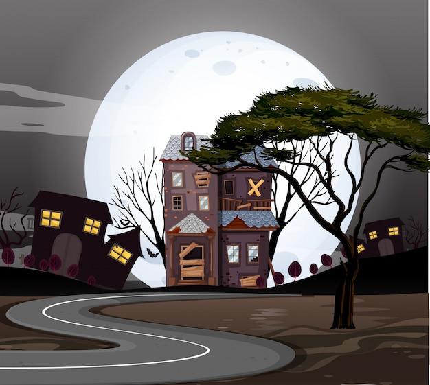 Case stregate sulla strada di notte