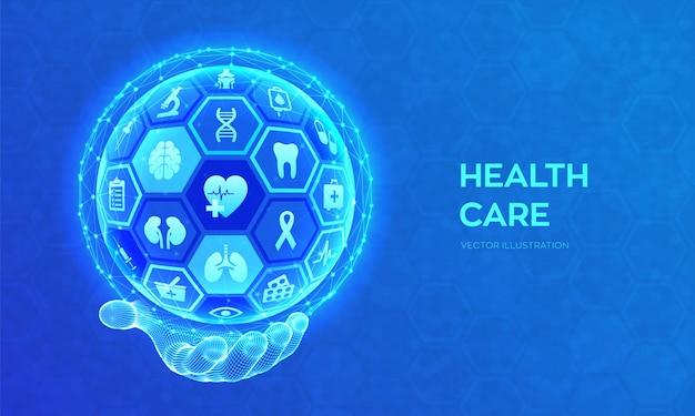 Concetto di assistenza sanitaria, medica, servizi di emergenza. sfera o globo astratta 3d con superficie degli esagoni con le icone in mano del wireframe.