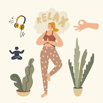 Donna in buona salute che fa asana yoga o esercizio di aerobica in piedi su una gamba sola che ascolta musica rilassante a casa