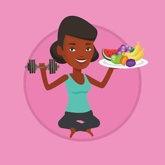 Donna in buona salute con la frutta e la testa di legno.