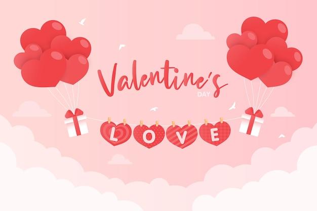 Palloncini cuore legati a una confezione regalo che fluttua nel cielo rosa con un messaggio di amore il giorno di san valentino.
