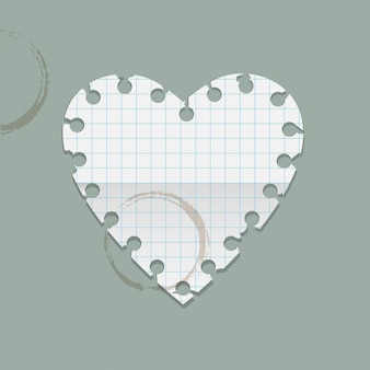 Nota di carta del cuore con macchie di caffè.