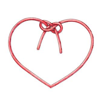 Cuore di filo rosso con un nodo.