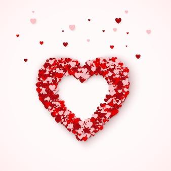 Sagoma di cuore, cornice del cuore composta da coriandoli di cuoricini. concetto di carta felice giorno di san valentino