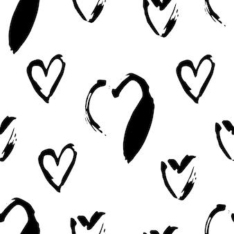 Reticolo senza giunte di cuori in bianco e nero. illustrazioni di simbolo di amore a mano libera su priorità bassa bianca. stampa tessile stile grunge cuori disegnati a mano. disegno della carta da regalo di san valentino