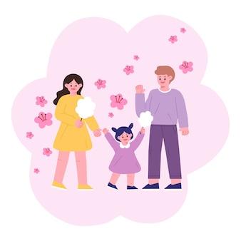 Ciao primavera. famiglia, mamma, papà, bambino con zucchero filato a guardare i fiori di ciliegio.