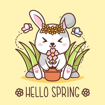 Ciao primavera con simpatici conigli con vaso di fiori