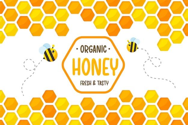 Sfondo di carta a nido d'ape giallo dorato esagonale tagliato con api che volano intorno con miele dolce.
