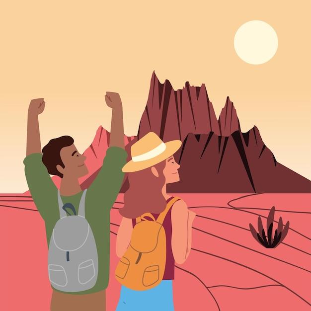 Coppia di escursionisti con borse nel deserto