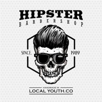 Logo del negozio di barbiere teschio hipster in bianco e nero