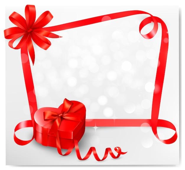 Sfondo vacanza con scatola regalo a forma di cuore rosso e nastro