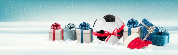 Banner natalizio con scatole regalo e pallone da calcio