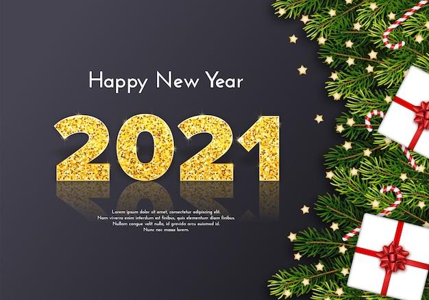 Carta regalo vacanza felice anno nuovo con numeri d'oro 2021, rami di abete, bastoncini di zucchero e fiocco