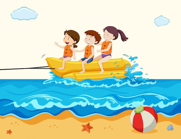 Holiday kids riding banana boat