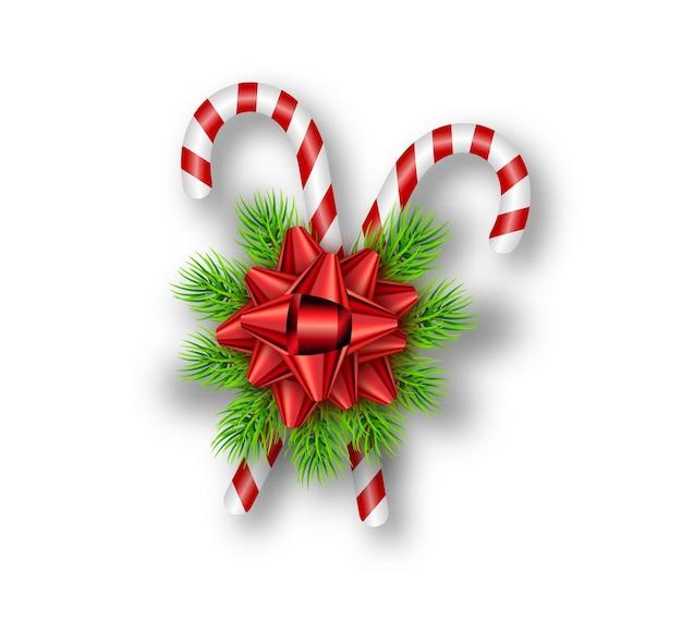 Fiocco rosso festivo, rami di abete, bastoncini di zucchero