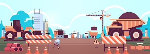 Macchine di concetto di ingegneria di costruzione domestica che costruiscono le case che lavorano sul cantiere