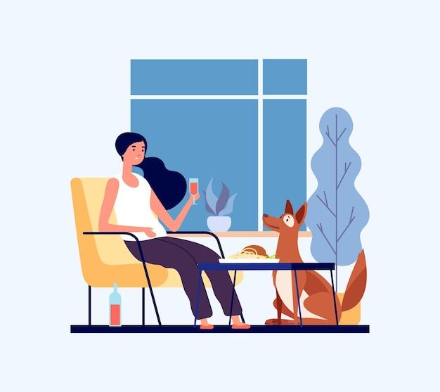 Concetto di cena a casa. donna con il suo cane in soggiorno.