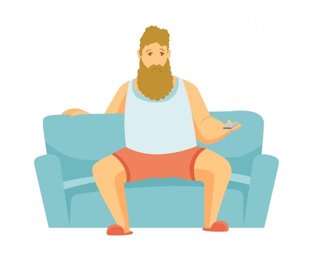 Tempo libero a casa. l'uomo della barba si siede sul divano e guarda la tv. persone tempo libero. stando a casa