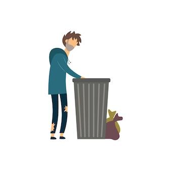 Mendicante affamato senza casa che scava nella spazzatura