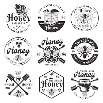 Miele e apicoltura set di nove emblemi neri, etichette, distintivi e loghi in vintage su sfondo bianco