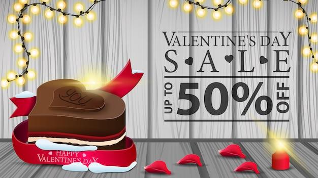 Insegna di sconto orizzontale di san valentino con caramelle al cioccolato