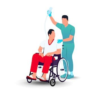Paziente in ospedale in sedia a rotelle con infermieri