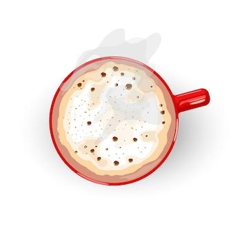 Bevanda calda con schiuma e fumo che si diffonde dalla tazza di porcellana rossa