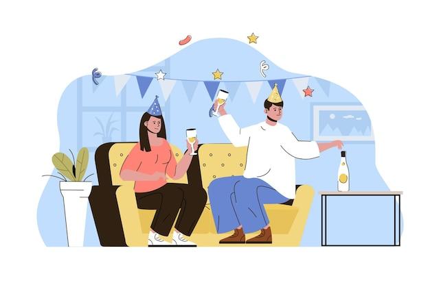 Concetto di festa in casa coppia che festeggia il compleanno bevendo e divertendosi