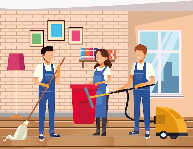 Lavoratori del team di pulizie che puliscono casa con strumenti di attrezzature